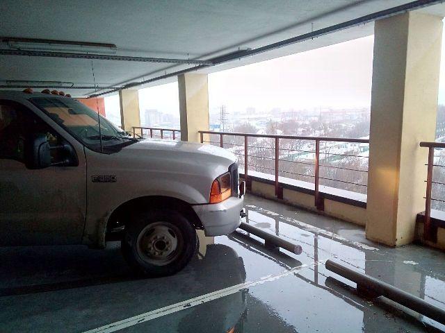 эвакуатор с наземных многоэтажных гаражей